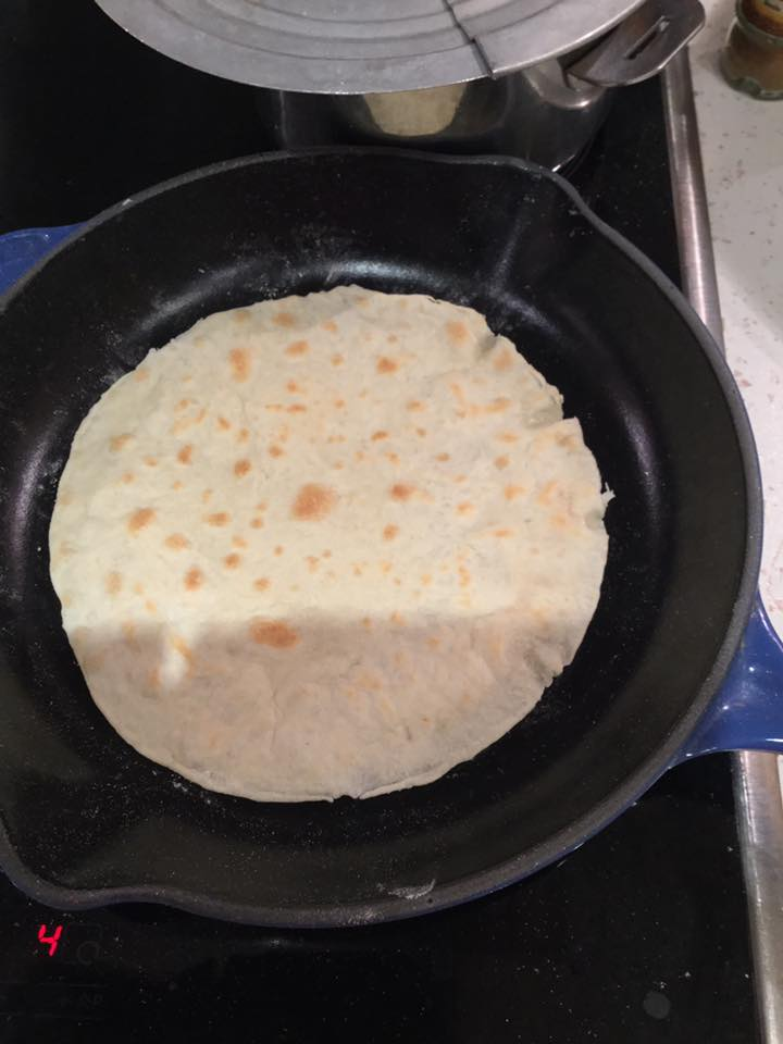 The tortilla in the cast iron pan